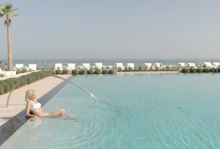 five-star-grecotel-white-palace-main-pool-with-sea-views