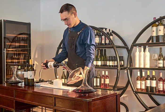 01-wine-library-tasting-room-in-grecotel-resort-white-palace