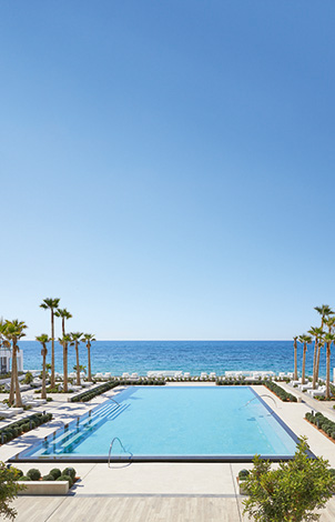 07-summer-big-blue-main-pool-in-grecotel-white-palace-in-greece
